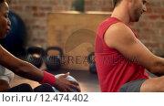 Купить «Fit people doing russian twist exercises», видеоролик № 12474402, снято 19 июля 2019 г. (c) Wavebreak Media / Фотобанк Лори