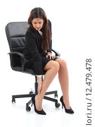 Купить «Businesswoman sitting and suffering feet ache», фото № 12479478, снято 15 ноября 2018 г. (c) PantherMedia / Фотобанк Лори