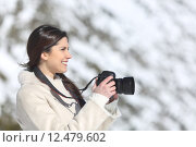 Купить «Tourist woman photographing on winter holidays», фото № 12479602, снято 23 июля 2019 г. (c) PantherMedia / Фотобанк Лори