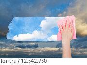 Купить «hand deletes dark cloudscape by pink cloth», фото № 12542750, снято 23 февраля 2019 г. (c) PantherMedia / Фотобанк Лори