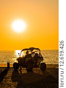 Купить «Quad motorbike by the sea at sunset», фото № 12619426, снято 15 декабря 2018 г. (c) PantherMedia / Фотобанк Лори