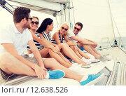 Купить «smiling friends sitting on yacht deck», фото № 12638526, снято 13 июля 2014 г. (c) Syda Productions / Фотобанк Лори