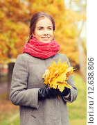 Купить «smiling woman with bunch of leaves in autumn park», фото № 12638806, снято 18 октября 2014 г. (c) Syda Productions / Фотобанк Лори