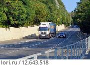 Купить «Обгон по встречке. Легковой автомобиль опережает грузовик-фуру по полосе встречного движения на трассе», эксклюзивное фото № 12643518, снято 13 августа 2015 г. (c) Александр Замараев / Фотобанк Лори
