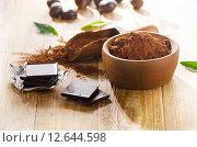 Купить «Chocolate bars and a bowl of cacao powder.», фото № 12644598, снято 8 августа 2015 г. (c) Tatjana Baibakova / Фотобанк Лори