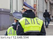 Купить «Инспекторы дорожно-патрульной службы на городской улице», фото № 12648594, снято 18 августа 2019 г. (c) FotograFF / Фотобанк Лори