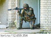 Купить «Military soldier with pistol», фото № 12659354, снято 14 июня 2015 г. (c) Дмитрий Калиновский / Фотобанк Лори