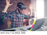 Купить «Surprised creative businessman wearing 3D video glasses», фото № 12663766, снято 14 мая 2015 г. (c) Wavebreak Media / Фотобанк Лори