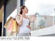 Купить «happy pregnant woman with shopping bags at city», фото № 12670166, снято 27 июля 2015 г. (c) Syda Productions / Фотобанк Лори