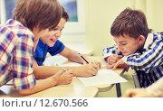 Купить «group of schoolboys writing or drawing at school», фото № 12670566, снято 15 ноября 2014 г. (c) Syda Productions / Фотобанк Лори