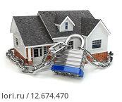Купить «Home security concept. House with lock and chain», фото № 12674470, снято 23 марта 2019 г. (c) Maksym Yemelyanov / Фотобанк Лори