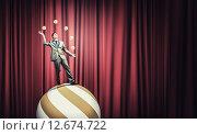 Купить «Businessman juggling with balls», фото № 12674722, снято 22 июля 2018 г. (c) Sergey Nivens / Фотобанк Лори