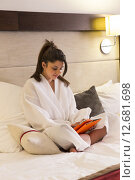 Young woman in hotel with digital tablet. Стоковое фото, фотограф Graham Oliver / PantherMedia / Фотобанк Лори