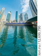 Купить «Dubai - AUGUST 9, 2014: Dubai Marina district on August 9 in UAE. Dubai is fastly developing city in Middle East», фото № 12690790, снято 9 августа 2014 г. (c) Elnur / Фотобанк Лори
