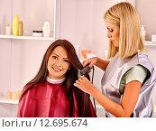 Купить «Woman at hairdresser.», фото № 12695674, снято 15 сентября 2012 г. (c) Gennadiy Poznyakov / Фотобанк Лори