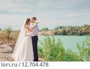 Купить «beautiful bride and groom outdoor», фото № 12704478, снято 28 августа 2015 г. (c) Майя Крученкова / Фотобанк Лори