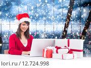 Купить «Composite image of festive brunette shopping online with laptop», фото № 12724998, снято 29 февраля 2020 г. (c) Wavebreak Media / Фотобанк Лори