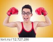 Купить «Funny boxer isolated on the white background», фото № 12727286, снято 15 апреля 2013 г. (c) Elnur / Фотобанк Лори