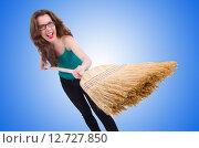 Купить «Young woman with broom isolated on white», фото № 12727850, снято 23 апреля 2013 г. (c) Elnur / Фотобанк Лори