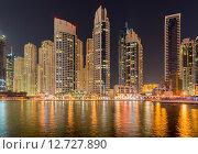 Купить «Dubai - JANUARY 10, 2015: Marina district on January 10 in UAE, Dubai. Marina district is popular residential area in Dubai», фото № 12727890, снято 10 января 2015 г. (c) Elnur / Фотобанк Лори