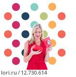 Купить «Composite image of stylish blonde in red dress opening gift box», фото № 12730614, снято 20 февраля 2019 г. (c) Wavebreak Media / Фотобанк Лори