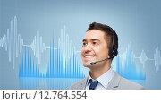 Купить «businessman in headset over sound wave or diagram», фото № 12764554, снято 29 января 2015 г. (c) Syda Productions / Фотобанк Лори