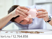 Купить «businessman with piggy bank and coins at office», фото № 12764858, снято 18 июня 2015 г. (c) Syda Productions / Фотобанк Лори