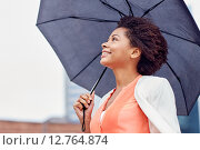 Купить «happy african american businesswoman with umbrella», фото № 12764874, снято 8 июля 2015 г. (c) Syda Productions / Фотобанк Лори