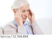 Купить «face of senior woman suffering from headache», фото № 12764894, снято 10 июля 2015 г. (c) Syda Productions / Фотобанк Лори