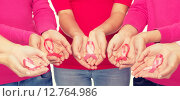 Купить «close up of women with cancer awareness ribbons», фото № 12764986, снято 2 сентября 2014 г. (c) Syda Productions / Фотобанк Лори