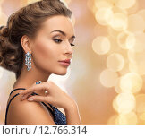 Купить «beautiful woman wearing ring and earrings», фото № 12766314, снято 17 марта 2013 г. (c) Syda Productions / Фотобанк Лори