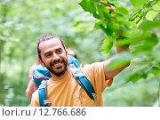 Купить «group of smiling friends with backpacks hiking», фото № 12766686, снято 25 июля 2015 г. (c) Syda Productions / Фотобанк Лори