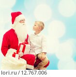 Купить «smiling little boy with santa claus and gifts», фото № 12767006, снято 14 сентября 2014 г. (c) Syda Productions / Фотобанк Лори