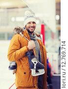 Купить «happy young man with ice-skates on skating rink», фото № 12769714, снято 26 ноября 2014 г. (c) Syda Productions / Фотобанк Лори
