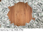 Купить «close up of dollar money on wooden table», фото № 12769770, снято 30 июля 2015 г. (c) Syda Productions / Фотобанк Лори