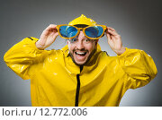 Man wearing yellow suit in funny concept. Стоковое фото, фотограф Elnur / Фотобанк Лори
