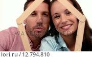 Купить «Casual couple holding house outline», видеоролик № 12794810, снято 31 марта 2020 г. (c) Wavebreak Media / Фотобанк Лори
