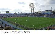 Купить «Football match before crowded stands at the stadium», видеоролик № 12808530, снято 5 апреля 2015 г. (c) Данил Руденко / Фотобанк Лори