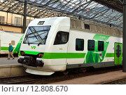 Купить «Поезд VR на железнодорожном вокзале в Хельсинки, Финляндия», фото № 12808670, снято 28 сентября 2015 г. (c) Валерия Попова / Фотобанк Лори