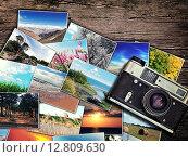 Купить «Фотографии пейзажей и старый фотоаппарат на деревянном столе», фото № 12809630, снято 13 апреля 2015 г. (c) Юрий Плющев / Фотобанк Лори