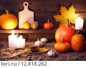 Купить «Осенний натюрморт с тыквами и свечами», фото № 12818262, снято 6 октября 2015 г. (c) Евдокимов Максим / Фотобанк Лори
