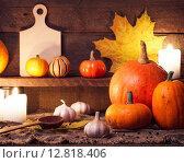 Купить «Тыквы на деревянном столе. Осенний натюрморт в деревенском стиле», фото № 12818406, снято 6 октября 2015 г. (c) Евдокимов Максим / Фотобанк Лори
