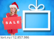 Купить «Composite image of pretty blonde in santa hat holding a red sale poster», фото № 12857986, снято 17 февраля 2019 г. (c) Wavebreak Media / Фотобанк Лори