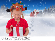 Купить «Composite image of cute little girl wearing rudolph headband», фото № 12858262, снято 16 июня 2019 г. (c) Wavebreak Media / Фотобанк Лори