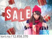 Купить «Composite image of shocked brunette opening gift bag», фото № 12858370, снято 21 августа 2018 г. (c) Wavebreak Media / Фотобанк Лори