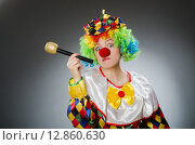 Купить «Clown with mic in funny concept», фото № 12860630, снято 12 июня 2015 г. (c) Elnur / Фотобанк Лори
