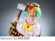 Купить «Clown with hammer in funny concept», фото № 12860830, снято 12 июня 2015 г. (c) Elnur / Фотобанк Лори