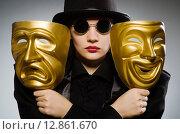 Купить «Woman with mask in funny concept», фото № 12861670, снято 23 августа 2015 г. (c) Elnur / Фотобанк Лори