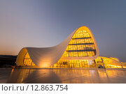 Купить «BAKU- JULY 20: Heydar Aliyev Center on July 20, 2015 in Baku, Az», фото № 12863754, снято 20 июля 2015 г. (c) Elnur / Фотобанк Лори