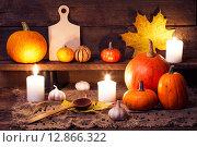 Купить «Тыквы на деревянном столе со свечами и кухонными аксессуарами», фото № 12866322, снято 6 октября 2015 г. (c) Евдокимов Максим / Фотобанк Лори